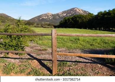 Wooden fence in Poway, California with Iron Mountain in the background.