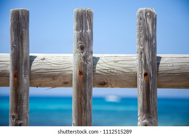 Wooden fence with the sea in the background