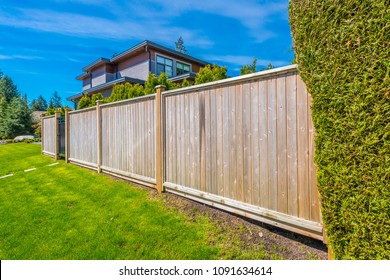 Wooden fence. Separate and protect private property.