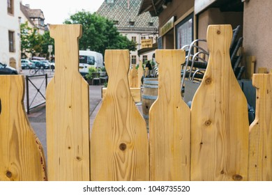 wooden fence in the shape of wine bottles
