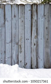 wooden fence in the winter