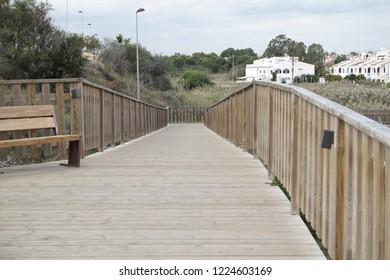 Wooden fenced walkway in Mil Palmeras in Spain