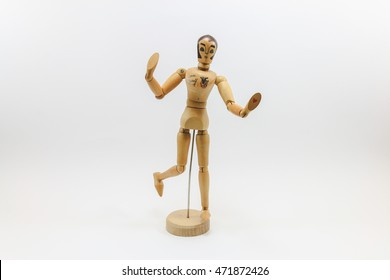 a wooden figure with art grafic