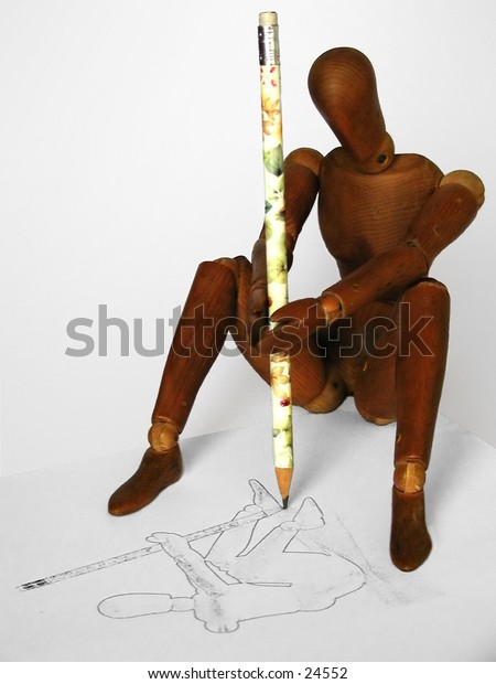Wooden figure drawing self-portrait.