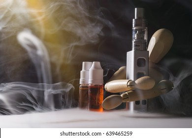 wooden figure selling eliquid and electronic cigarette idea, for vaing devices.