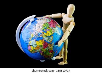 Wooden figure standing hug globe model