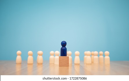 Wooden figure standing on the box for show influence and empowerment. Concept of business leadership for leader team, successful competition winner and Leader with influence