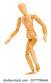 wooden figure in standing tiptoe pose isolated on white background, Include clipping path.