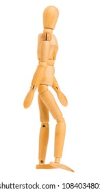 wooden figure in step of walking pose isolated on white background, Include clipping path.