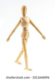 Wooden figure walking  on white background