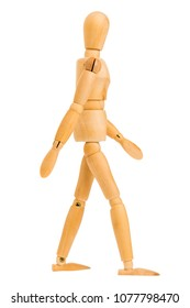 wooden figure in walking step pose isolated on white background, Include clipping path.