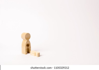 A wooden figure of a woman with a void from which a child fell. The concept of the loss of a child, abortion of pregnancy, miscarriage. mother lost her child. Deprivation of parental rights.