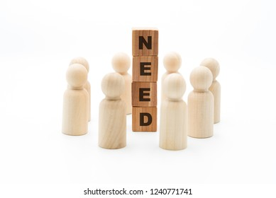 Wooden figures as business team in circle around word NEED, isolated on white background, minimalist concept