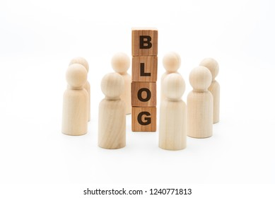 Wooden figures as business team in circle around word BLOG, isolated on white background, minimalist concept