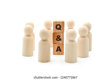 Wooden figures as business team in circle around acronym Q&A Questions and Answers, isolated on white background, minimalist concept
