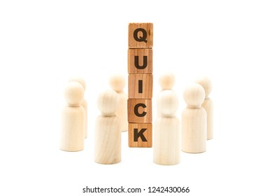 Wooden figures as business team in circle around word QUICK, isolated on white background, minimalist concept