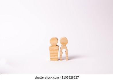 Wooden figures of a man and a woman with a void inside the body in the form of a child. Infertility in a couple. Loss of a single child. Medical problems. The couple wants to have a baby.