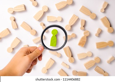 Wooden figures of people are lying on a white background. Social network. Business. The concept of human resources management. Headhunters. Search for people to work. The search for the second half.