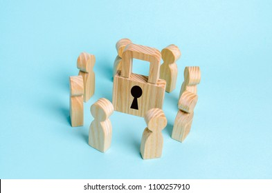 Wooden figures of people stand around a padlock. The concept of security and security, the protection of personal data and privacy policy. Bank secrecy, medical secret. Lock without key