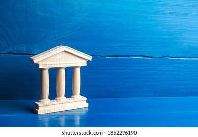 Wooden figurine of a government building or a bank. Court and judiciary, state authorities. Historical architectural monuments. University and library. Tourism and travel. Place for text. Copy space.
