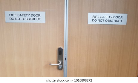 Wooden fire safety doors with do not obstruct sign