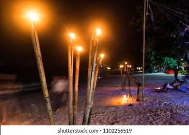 wooden fire torches at the beach