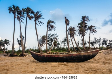 Wooden fishing boat in a beach in Mandarmoni by bay of bengal sea.