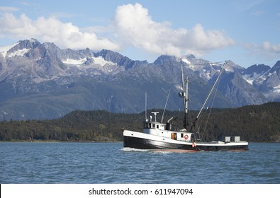 Wooden fishing boat in the Chilkat Inlet in Southeast Alaska in summer.