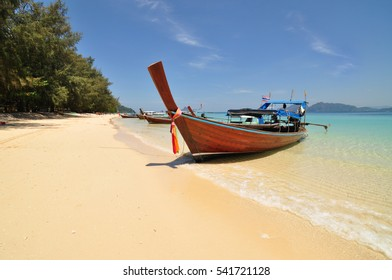 Wooden fishing boat on the beach with blue sky , n thailand