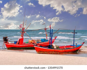 Wooden fishing boat on the beach/Fishing boat on the beach under blue sky background in Thailand.