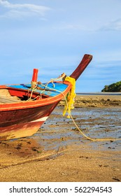 Wooden fishing boat on the beach//Fishing boat on the beach blue sky background in the Thailand/Fishing boat close up at the beach/Old boat at the beach/
