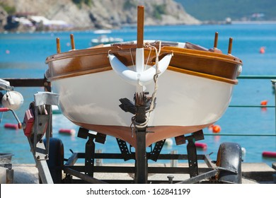 Wooden fishing boat stands on the coast of Adriatic sea. Petrovac, Montenegro