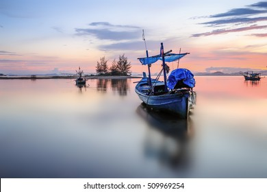 Wooden fishing boat in sunset time,Thailand