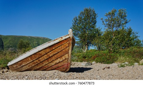wooden fishing boat, unattended on a beach near Borg, Lofoten Islands