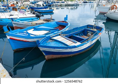 Wooden fishing boats on the old port in Palermo, Sicily