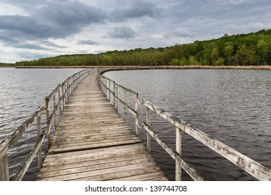 Wooden floating bridge on a lake.