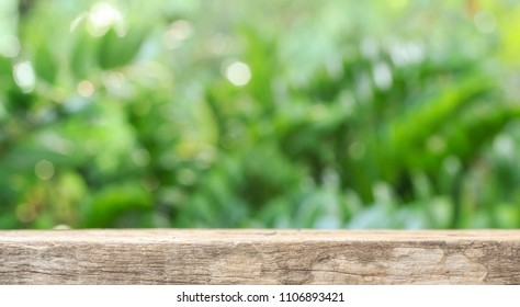 wooden floor with abstract blurred background in green nature. use for backdrop or web design in environment concept.