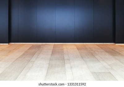 wooden floor and black wall interior background
