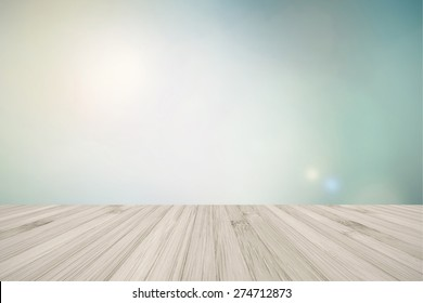 Wooden floor with blur abstract background of clouds and sky for interiors