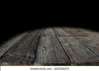 Wooden floor boards and black background