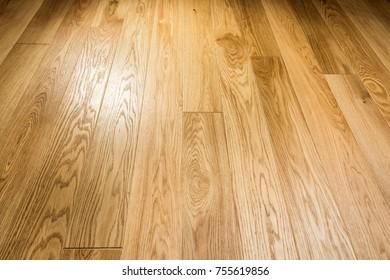 Wooden floor. Brushed, waxed oak floorboards.