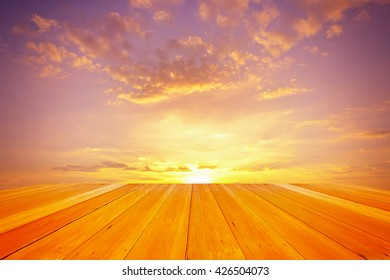 wooden floor with colorful summer sunset sky over agriculture farm