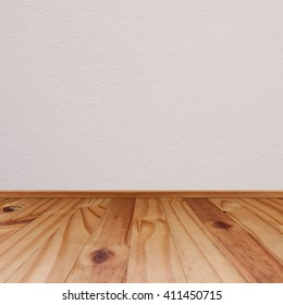 Wooden floor and concrete wall