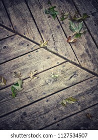 Wooden floor with leaves
