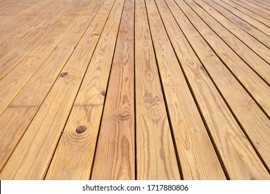 Wooden floor made of uncolored boards, background photo texture with perspective effect