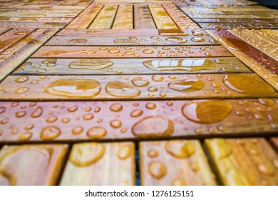 a wooden floor with many drops of water