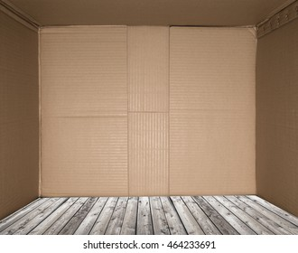 Wooden floor in the middle of the box. Space for copy.