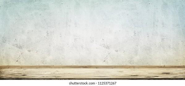Wooden floor over concrete wall background