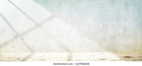 Wooden floor over concrete wall with sunlight from window background
