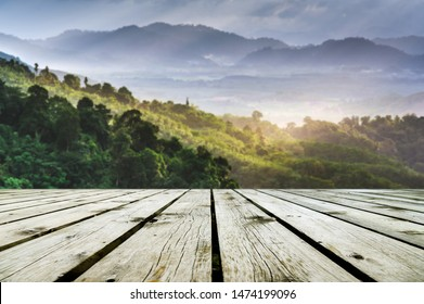 Wooden floor or plank on Green Forest on the blurred background; For product display.